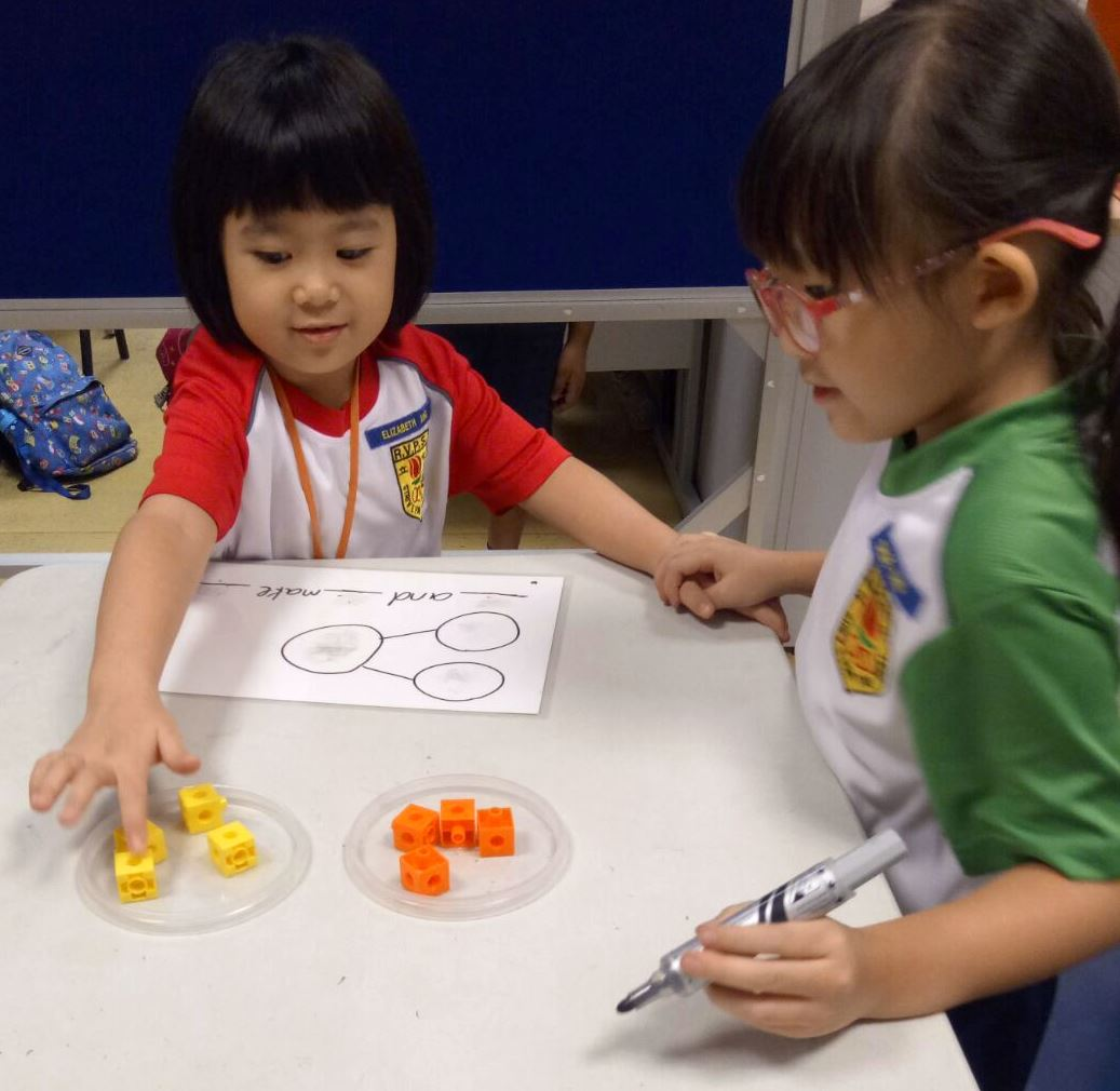 Students using cubes for the topic of number bonds.jpg